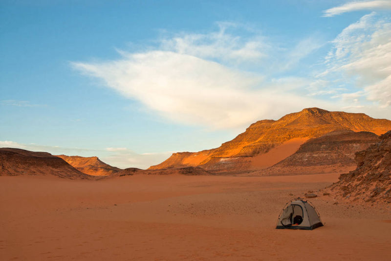 Night camp in Great Sand Sea desert, A Tend protect gears during sand storms
